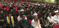 graduates sitting at ceremony
