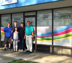 Minuteman Press printing franchise staff in Carlsbad, CA - pictured from left to right: Graphic Design Manager Ron Jones, Production Manager Bill Hawk, Customer Service Manager Karina Revita, Production Specialist Shane Sirota, and Franchise Owner Jeff Si