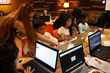 OmniUpdate employees providing technical support to middle school aged girls during TechGirlz workshop
