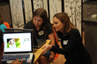 OmniUpdate Customer Training Manager, Breanna Scott, assists attendee during TechGirlz workshop