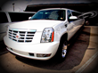 Cadillac Escalade 18 Passenger Limousine with 3 stocked bars, ice, soda, champagne and red carpet service.