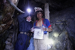 Johnson shares an embroidered piece with worker Ricky Martin in the Cerro Rico Mine in Potosi, Bolivia