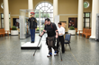 Austin Reece, a veteran Marine with spinal cord injuries and extremity paralysis, demonstrates Ekso GT suit at July 4 Arlington Cemetery ceremony.