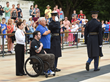 Fraternal Order of Eagles, Ekso Bioics and veteran Austin Reese pay respects at Arlington Cemetery's Tomb of the Unknown Soldier July 4.
