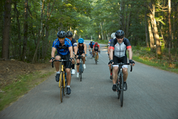Bicyclists in Eagle River forest