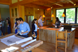 During the NESEA Pro Tour, participants looked at blueprints for the CreekSide net zero house. Custom cabinetry by NEWwoodworks can be seen in the background.