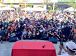 Reika Takes a Picture with the Audience