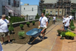 A team of volunteers from Citrin Cooperman work to beautify the main courtyard at Eva's Village.