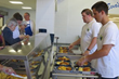Volunteers from Citrin Cooperman help serve lunch to nearly 400 guests in Eva's Village Community Kitchen.