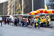 The famous never-ending line at The Halal Guys original food cart in NYC