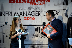 Cata Stef Accepting Business Magazine's Top Young Manager Award