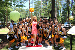 Former cheerleader, LEEZA GIBBONS, arrives at the opening of LEEZA'S CARE CONNECTION in her hometown of Irmo, SC. It was truly a Throwback Thursday moment. Photo by Nicholas Colucci.
