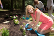 Leeza Gibbons plants a flower in the memory garden at the grand opening of LEEZA'S CARE CONNECTION in her hometown of Irmo, South Carolina. Photo credit: Jeff Amberg