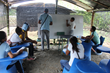 Students attend school in new classroom shelters.