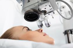 A woman undergoing an eye exam