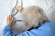 Equal Arts creative ageing project lady making artwork