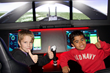 STEM Saturday students try out a flight simulator.