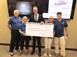 Avitus Group Business Development Manager & Honor Flight Volunteer Chris Balster Presents Rocky Mountain Honor Flight Board of Directors with Check for Business Challenge