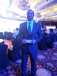 Krishna Chintam, Managing Director, Kellton Tech poses with the award