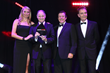 Andy Bruce, Lookers CEO receiving the Award from Jodie Kidd at Motor Trade Awards