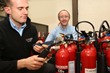 Stan Dancy overseeing fire extinguisher servicing training