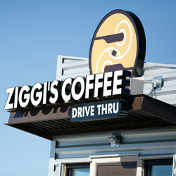 The exterior of a Ziggi's Coffee double-sided drive-thru location, which is one of the store concepts available to franchise.
