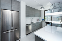 The remodeled kitchen at 300 East 54th Street, New York, NY. Aparment renovation by MyHome Design + Remodeling, NYC's leading general contractor.