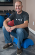Dr. Amis in a home gym with One Stretch. (Image Provided)