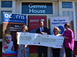 Gemini Director, Jason Moore presents cheques to both charities