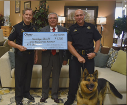 Olum's presents check to county sheriff's office