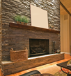 Fireplace, beautifully framed with stone clone panels