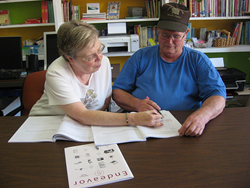 A tutor from Rockingham County Literacy Project in Eden, N.C., a past National Book Fund recipient, uses an educational book to teach an adult learner to read.