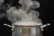 There are holes at the top that will allow the hot vapor to escape while it's cooking.