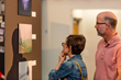 Attendees Explore a Photography Exhibit at Thin Line 2016