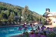 "Antlers at Vail hotel's ""pool with a view"" overlooks Vail Mountain and rushing Gore Creek with two hot tubs for relaxing muscles tired from the day's activities."