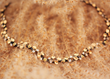 Wild Harvest. 18K yellow gold, white diamond and yellow sapphire necklace by Audrius Krulis