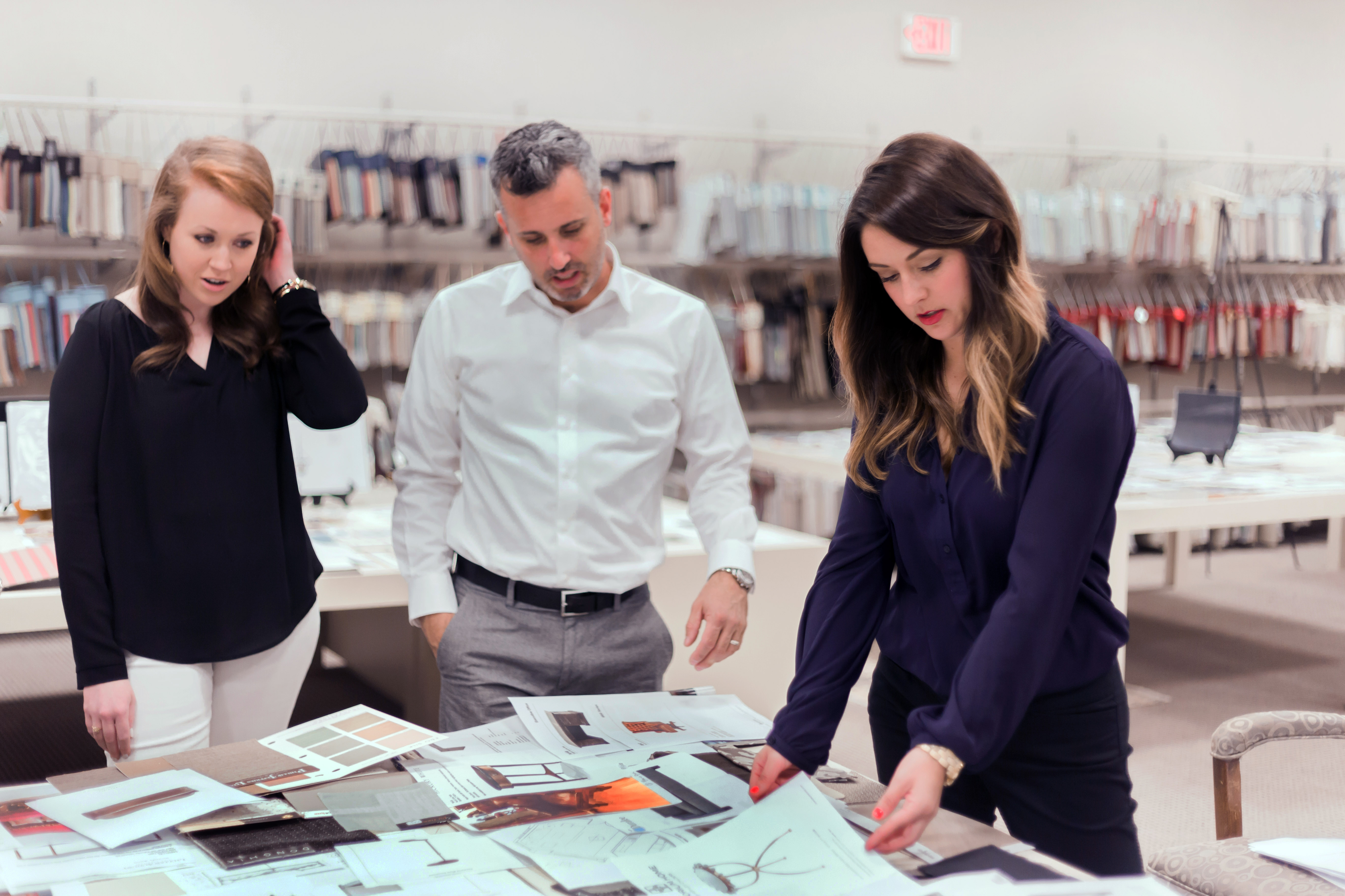 FSU Graduate Pineapple House Senior Designer Zach Azpeitia Is Shown With Designers Kate Fleming And Katie Moorhouse In The Library