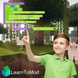 Boy Modding Minecraft using the LearnToMod software