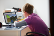 Boy using LearnToMod Minecraft Modding E-Learning Software