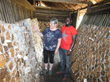 Dr. Sandra Williams of Mushrooms in Ghana Project works with a Ghanaian oyster mushroom farmer.