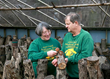 Sandra and Douglass Williams of Lost Creek Mushroom Farm with Shiitake logs