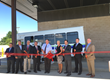 Delaware Department of Transportation (DelDOT) Secretary Jennifer Cohan, along with other officials, cut the ribbon to celebrate the Delaware Transit Corporation's (DTC) new propane fuel station in New Castle along with the agency's plans to increase its