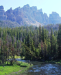 Fishing in trout-filled Shoshone National Forest backcountry rivers and lakes is one of several fresh air activities to enjoy at Brooks Lake Lodge & Spa in Wyoming.