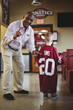 Billy Sims with boy with jersey