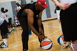Dr. J dribbles the ABA style balls that were gifted to youth participants by Grab A Ball & Play Foundation
