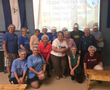 Residents of Friendship Village and Volunteers Pack Nearly 100 Boxes of Food at Feed My Starving Children