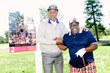 Julius Erving and Cedric the Entertainer pose for a picture in front of an Erving on-course Museum piece at last year's event