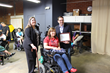 UCPLA Client Rights Advocate Terri Lantz (left) poses with LA County Registrar Recorder Dean Logan (right) and a self-advocate at UCPLA's Washington Place Adult Day Program.