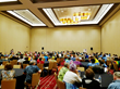 A crowd listens to industry speakers at the World Massage Festival