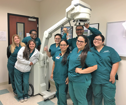Keiser-University-Radiology-Students-with-donated-portable-x-ray-machine